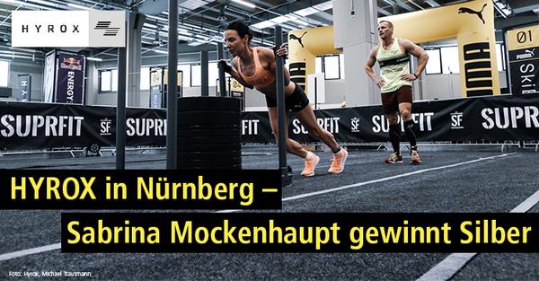Marathonläuferin Sabrina Mockenhaupt beim Sled Push bei HYROX Nürnberg