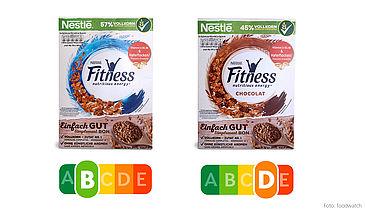 """Beide Produkte werben mit """"Fitness"""" und geben sich somit einen gesunden Anstrich – der Nutri-Score zeigt jedoch, dass Figurbewusste von der Schokoladen-Variante besser die Finger lassen sollten. Der deutlich höhere Gehalt an Zucker und gesättigten Fettsäuren führt zum schlechteren Nutri-Score."""